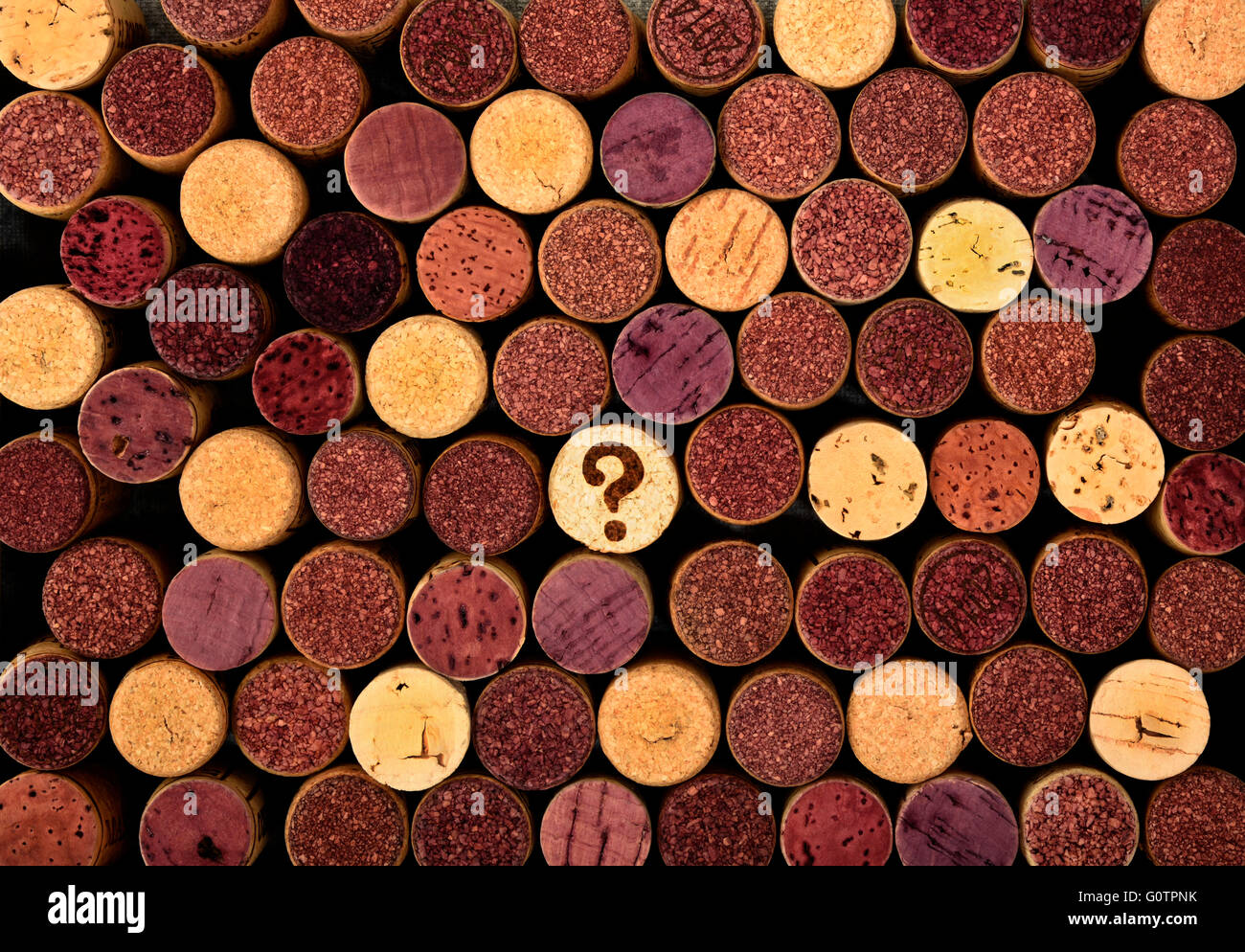 collection of wine corks with a question mark on one of them - Stock Image