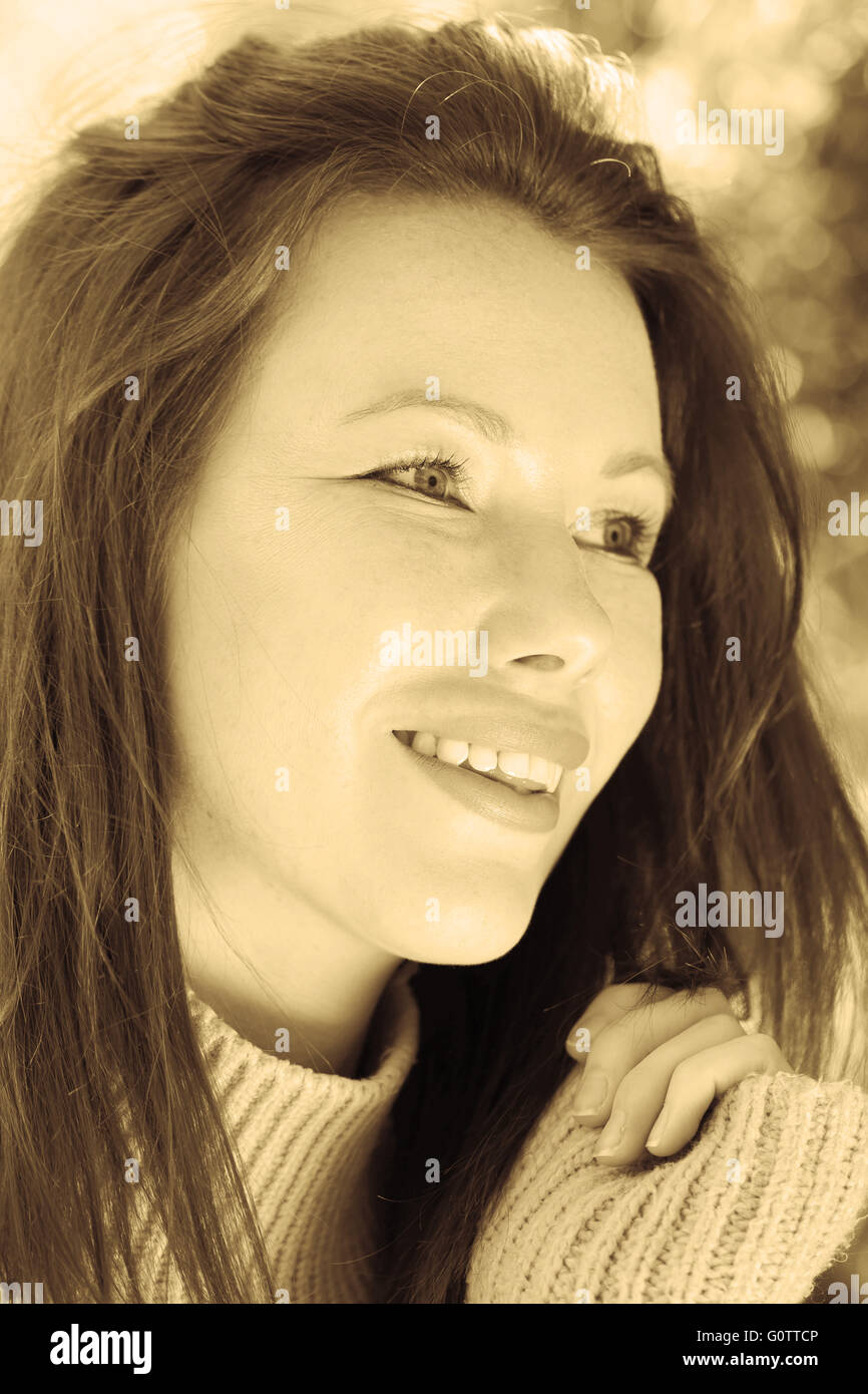 Toned Sepia Portrait of a Woman Smiling and Happy - Stock Image