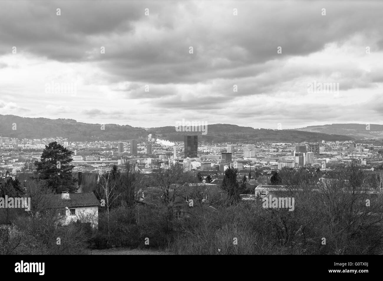 Aerial view of the skyline of industry and business area of Zurich from Irchelberg, Switzerland. Photo in Black - Stock Image