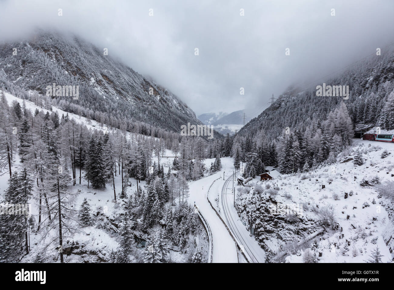 Beautiful view of swiss alps in winter on the famous sightseeing train glacier express, Switzerland. - Stock Image