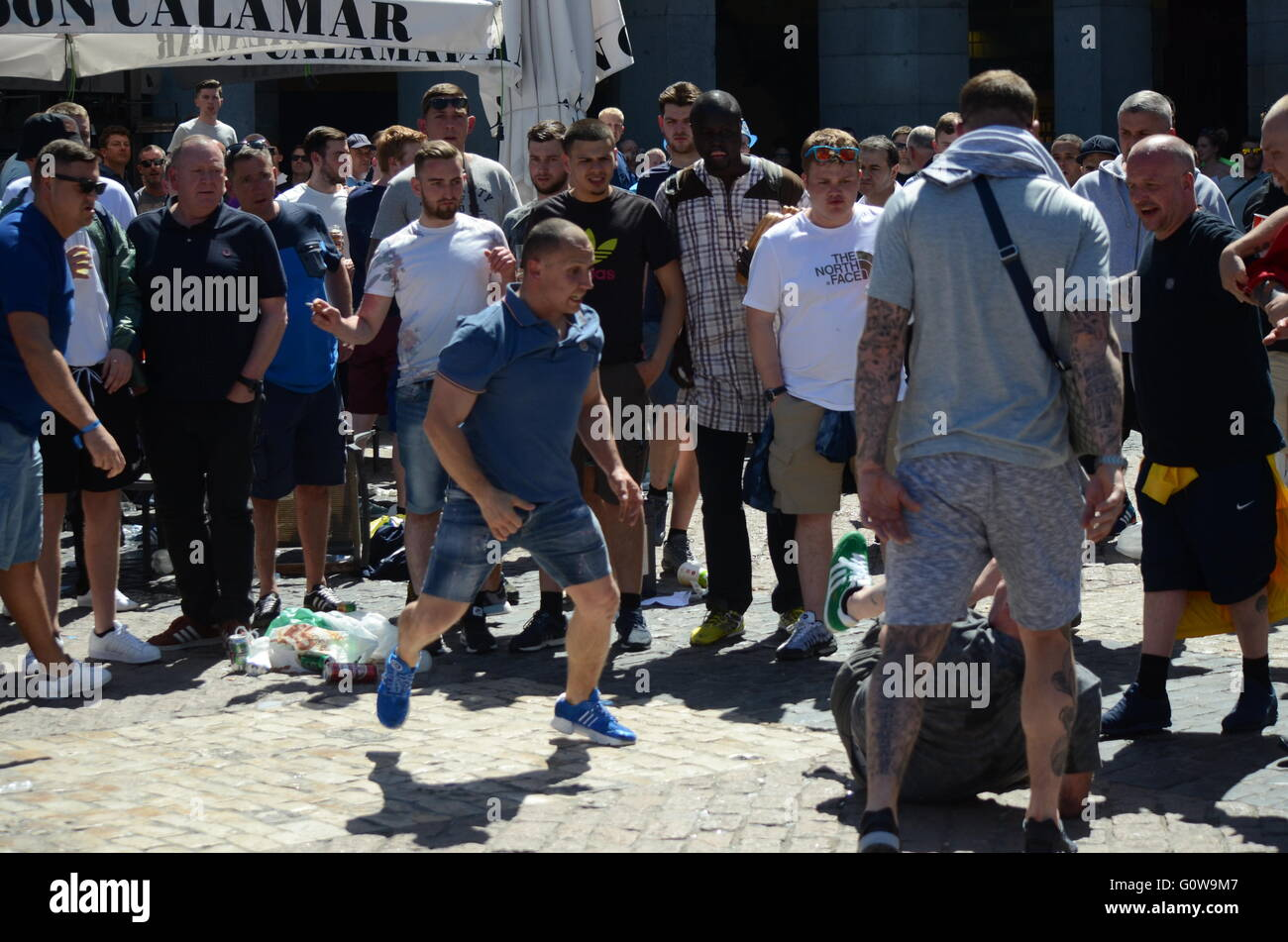 Madrid, Spain. 04th May, 2016. Two Manchester City fans pictured hitting each other in Madrid. Nearly 10,000 Manchester Stock Photo