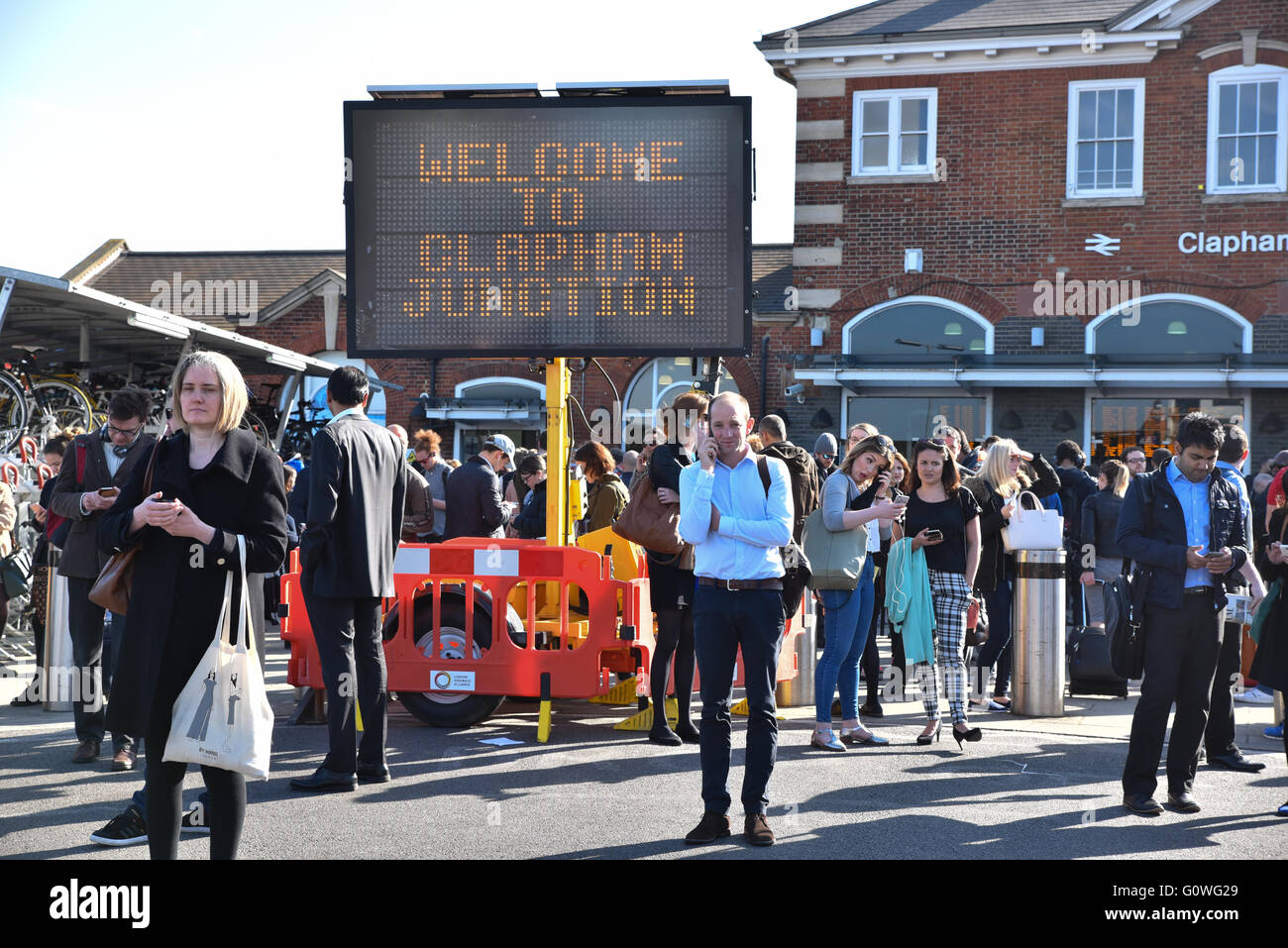 Clapham Junction, London, UK. 5th May, 2016. Commuters ouside Clapham Junction Station after the evacuation, - Stock Image