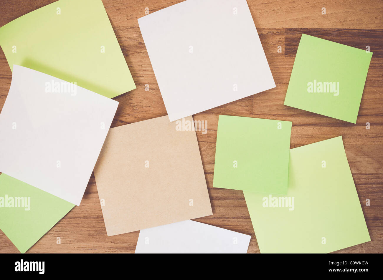 scattered blank post it on a wood tabletop - top view - Stock Image