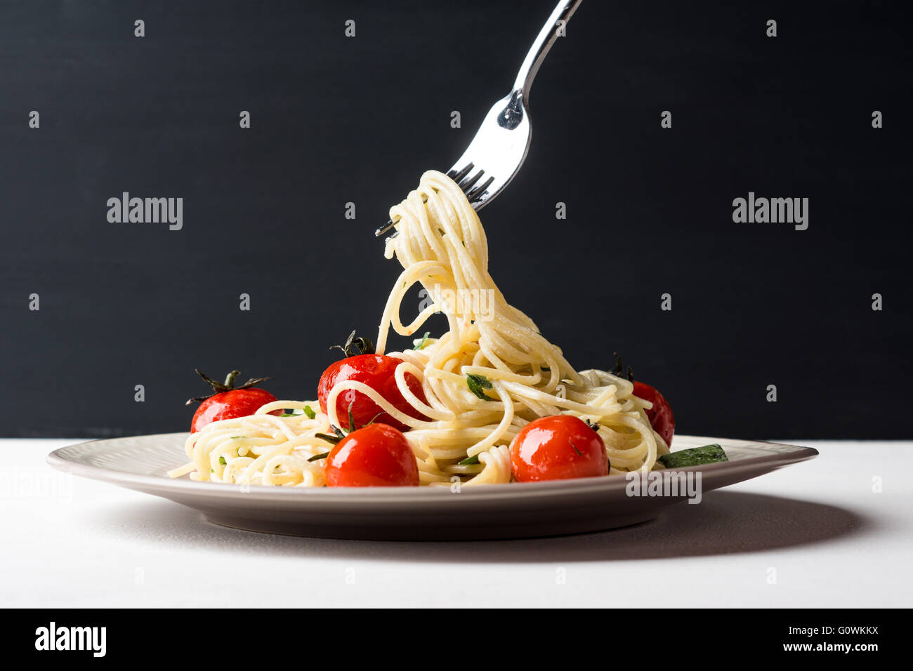 Pasta with cherry tomatoes. Selective focus. - Stock Image