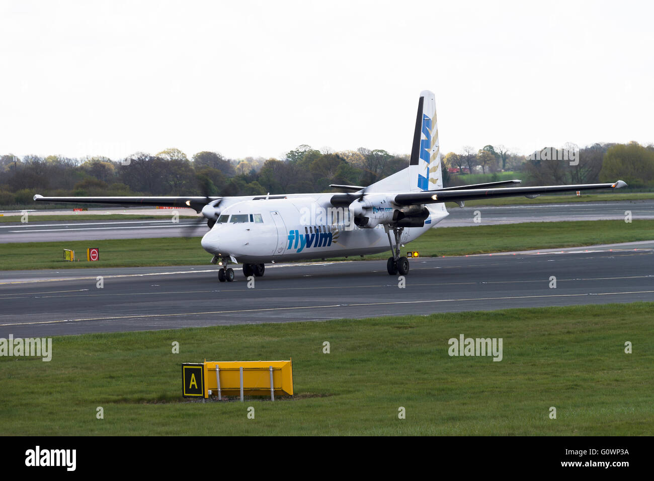 VLM Airlines Fokker 50 Turboprop Airliner OO-VLI Taxiing at Manchester International Airport England United Kingdom - Stock Image