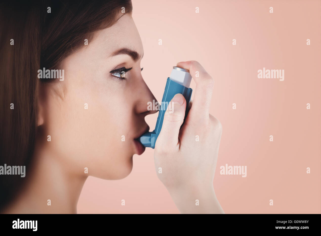 Composite image of portrait of an asthmatic woman - Stock Image