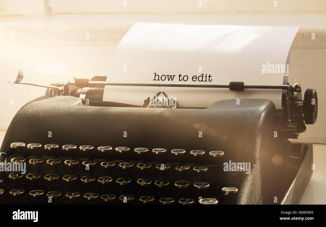 How to edit against typewriter on a table - Stock Image