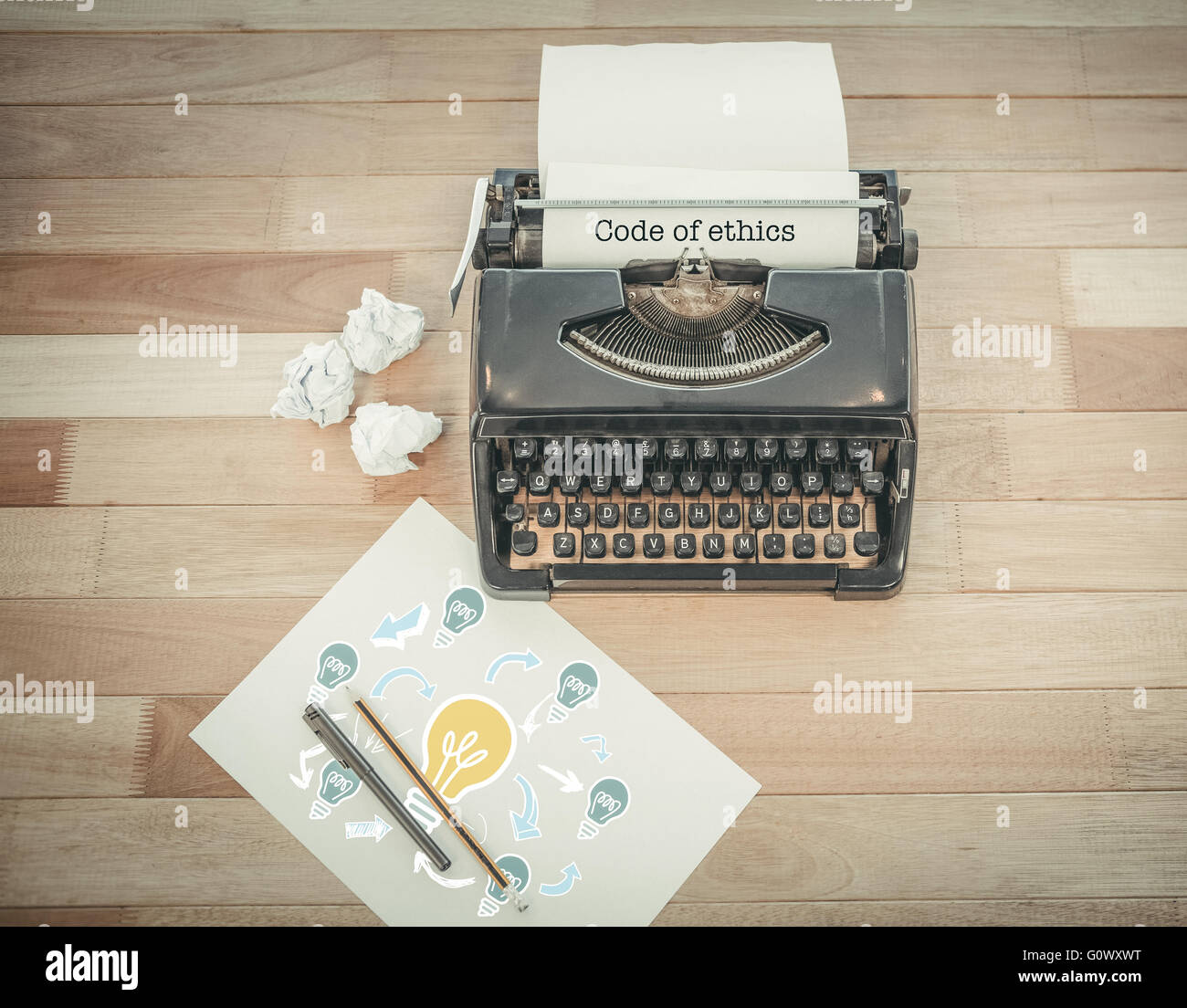 Code of ethics against typewriter and paper on table in office - Stock Image