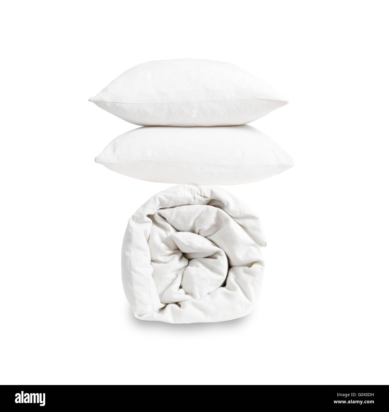 Pillows and duvet on white background - Stock Image