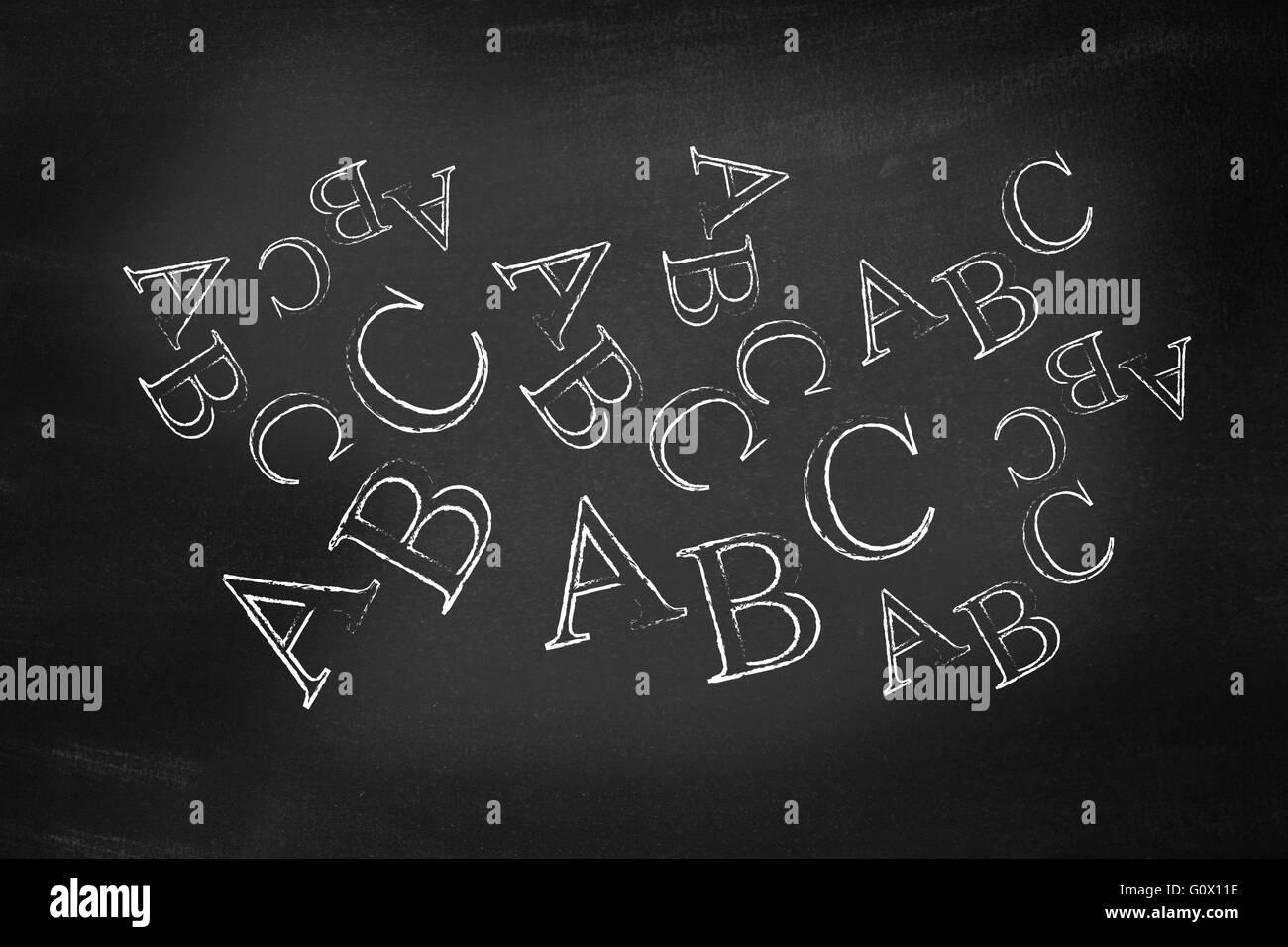 ABC written on a blackboard - Stock Image