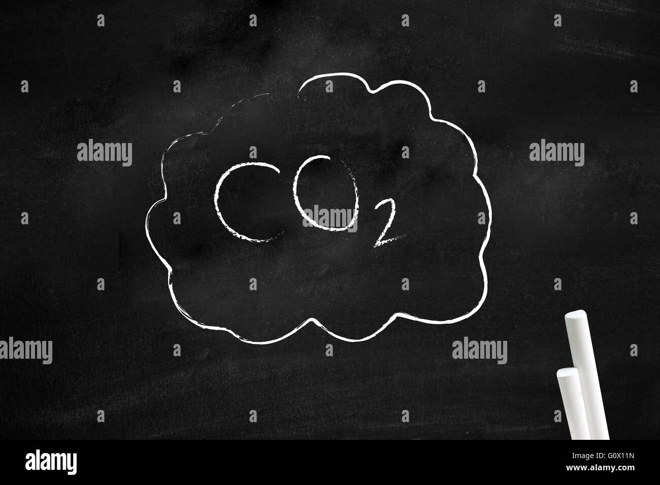 CO2 written on a blackboard - Stock Image