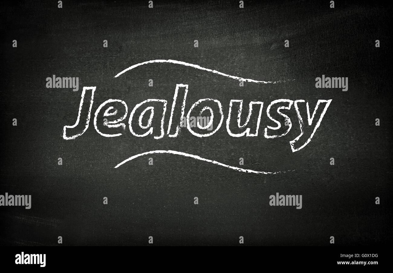 Jealousy written on blackboard - Stock Image