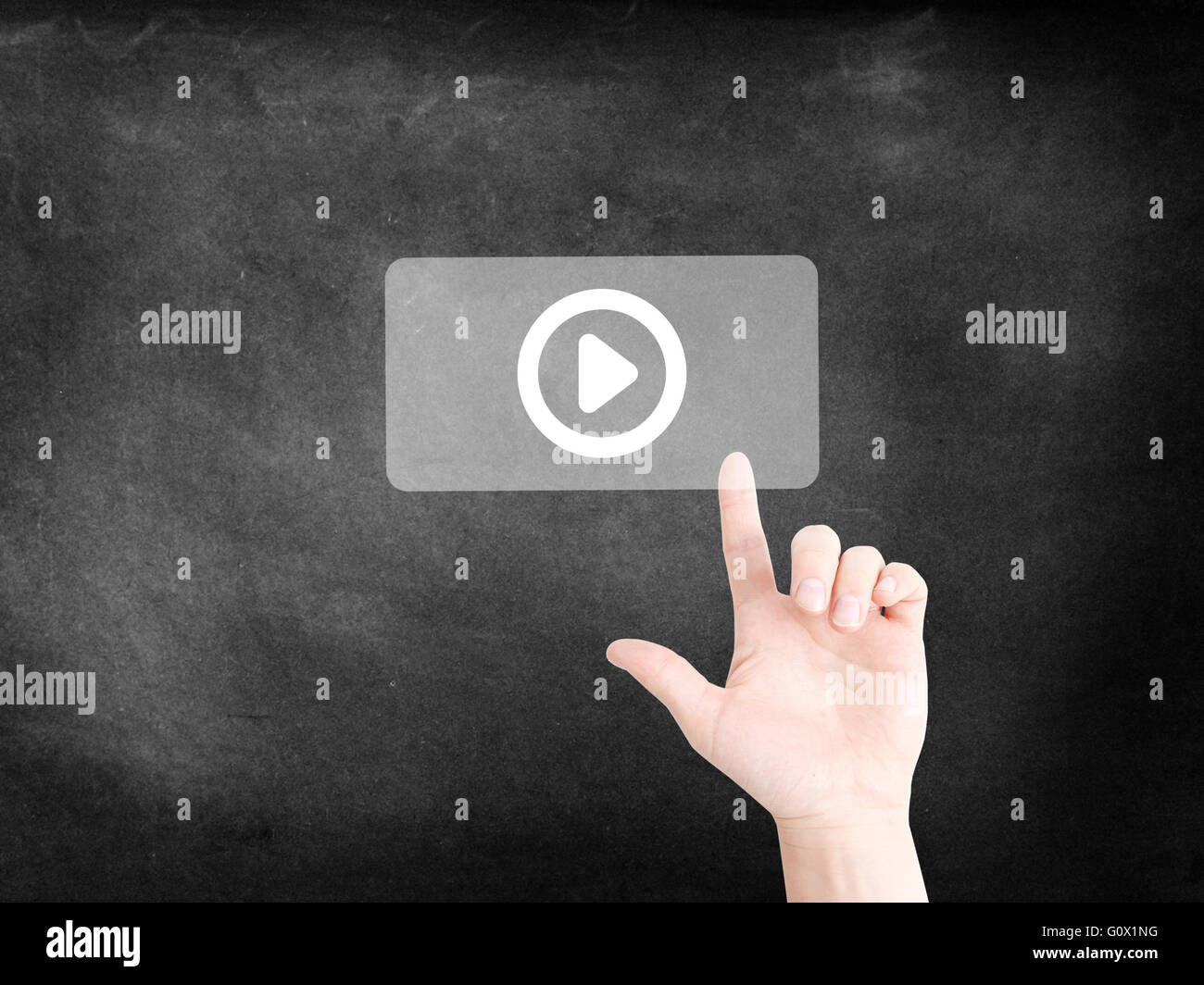 Tapping on a play icon - Stock Image