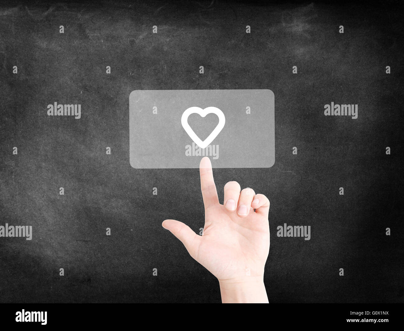Finger tapping on an icon to symbolize a heart - Stock Image