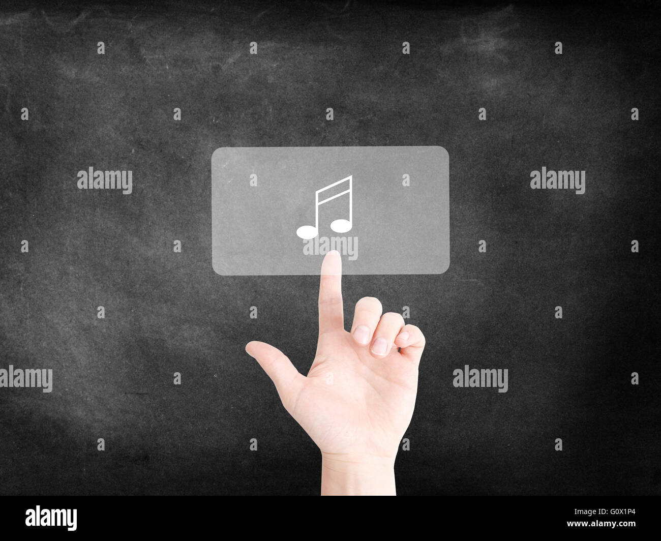 Finger tapping on an icon to symbolize music - Stock Image