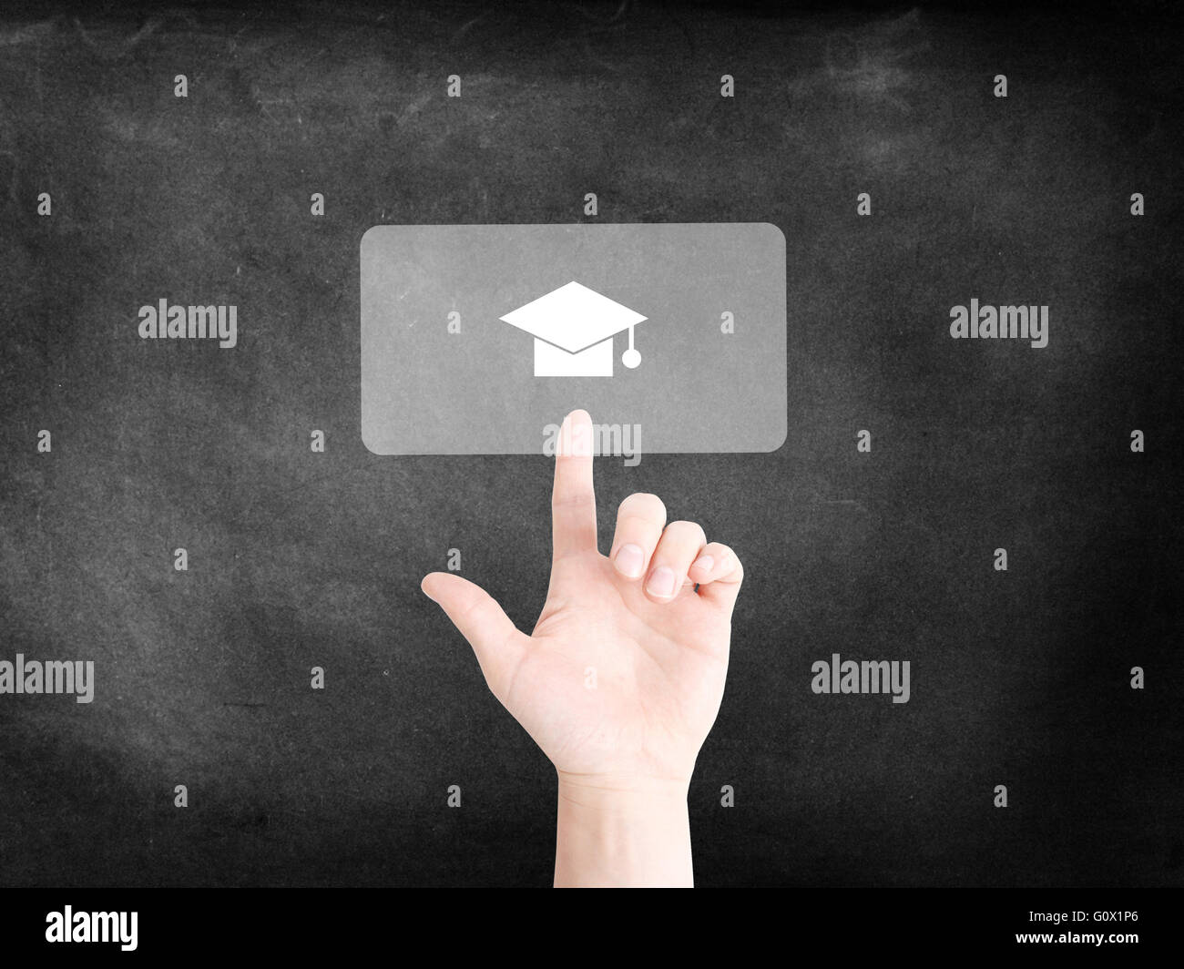 Finger tapping on an icon to symbolize education - Stock Image