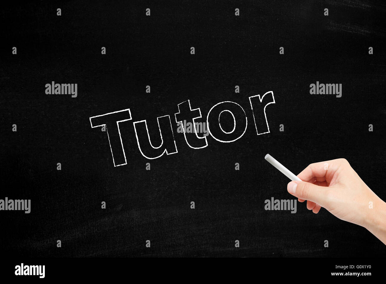 Tutor written with chalk - Stock Image