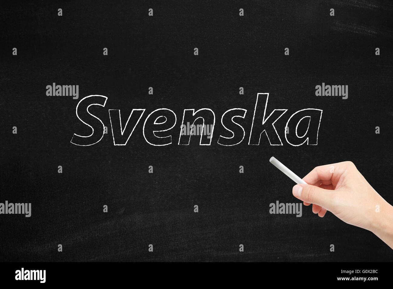 The language of Sweden, Svenska, written on a blackboard - Stock Image