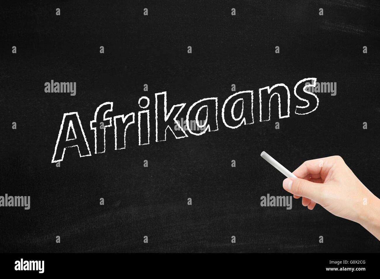 The language of Afrikaans written on a blackboard - Stock Image