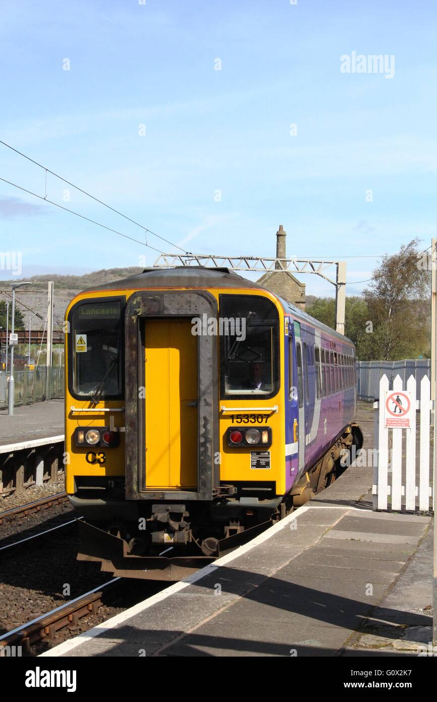 Class153 diesel unit in Northern livery arriving at Carnforth railway  station with a passenger service to