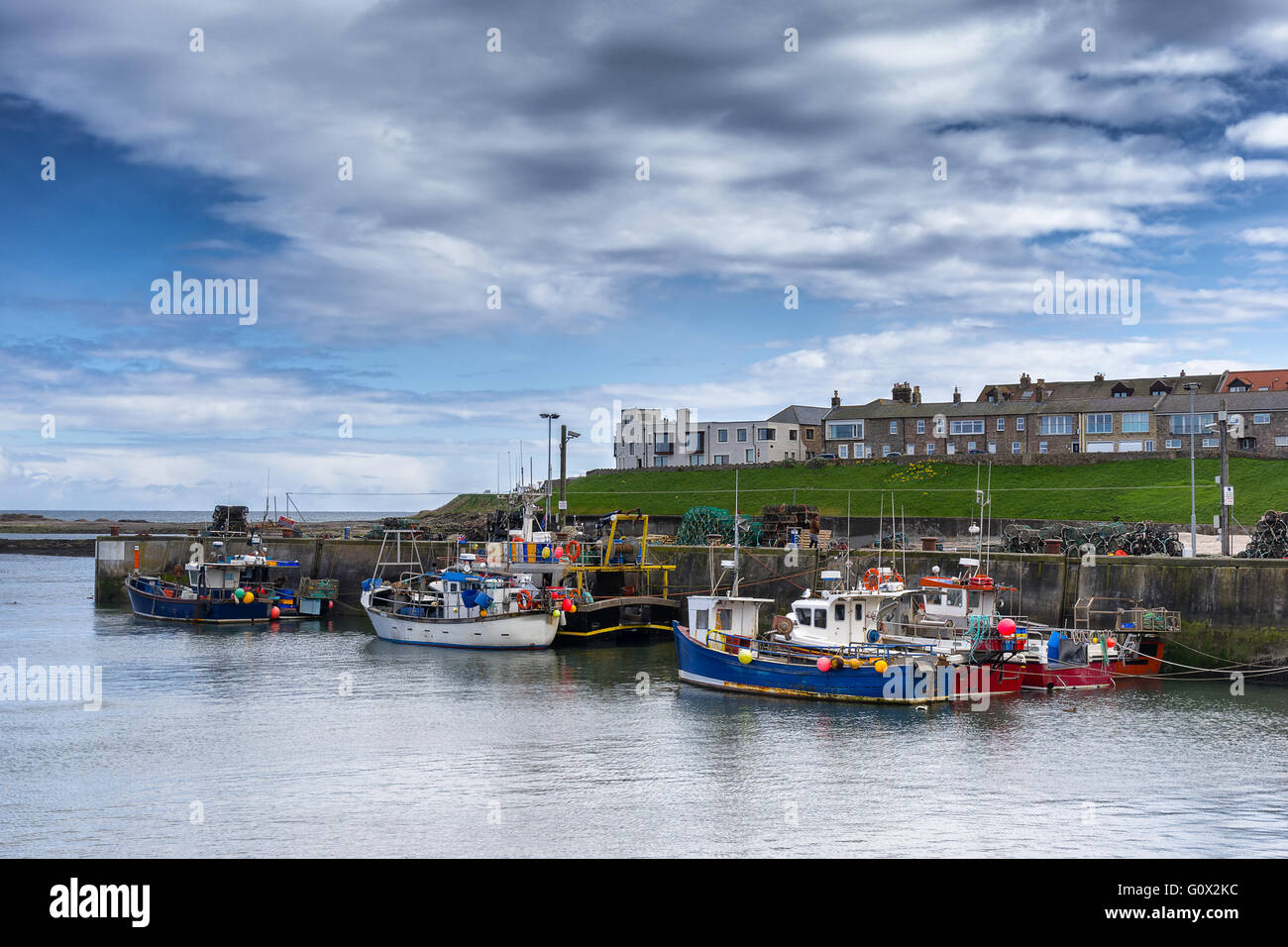 Seahouses harbor on the coast of Northumbria - Stock Image
