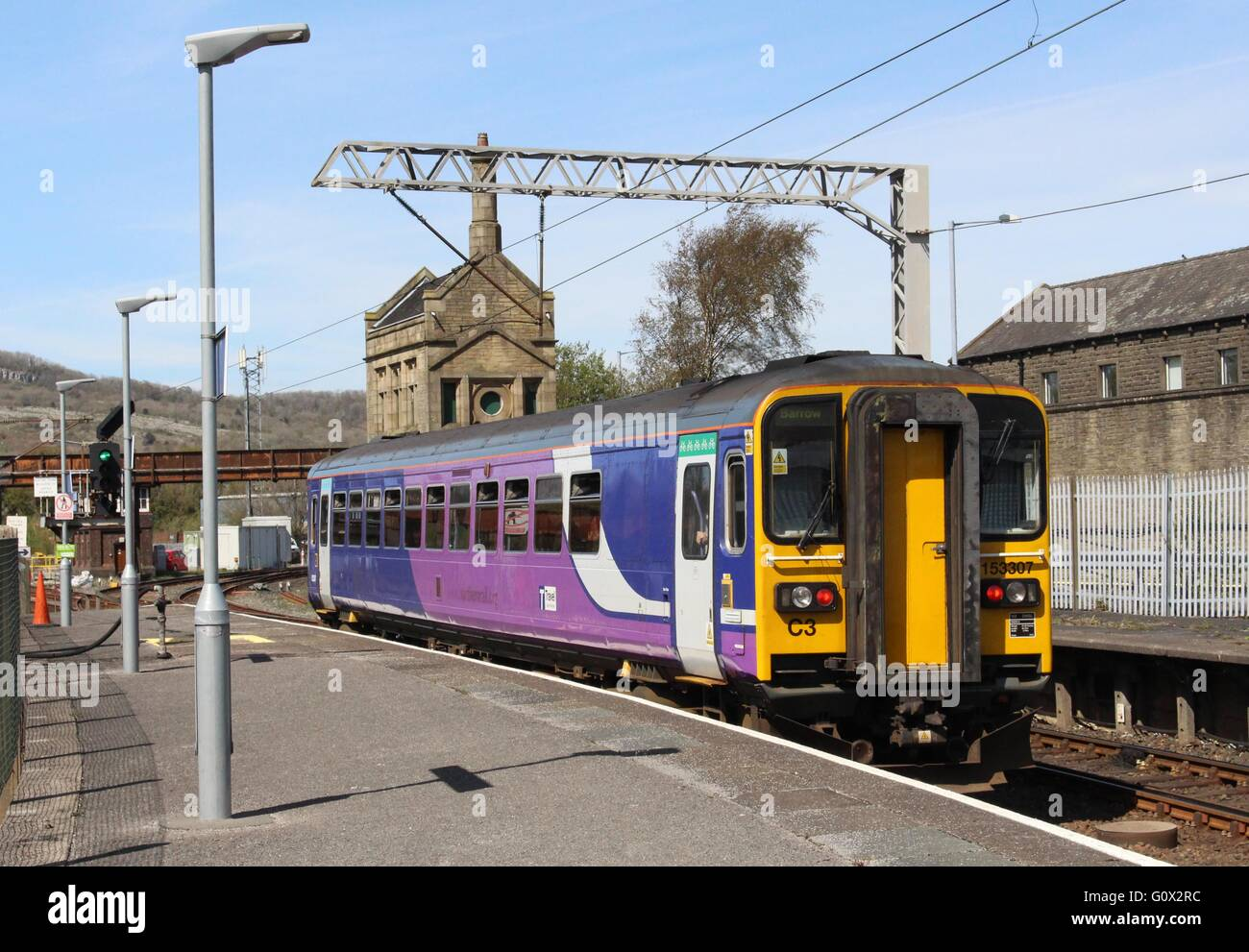 (Northern) class 153 diesel unit leaving Carnforth. Train  in Northern livery but with branding removed when franchise - Stock Image