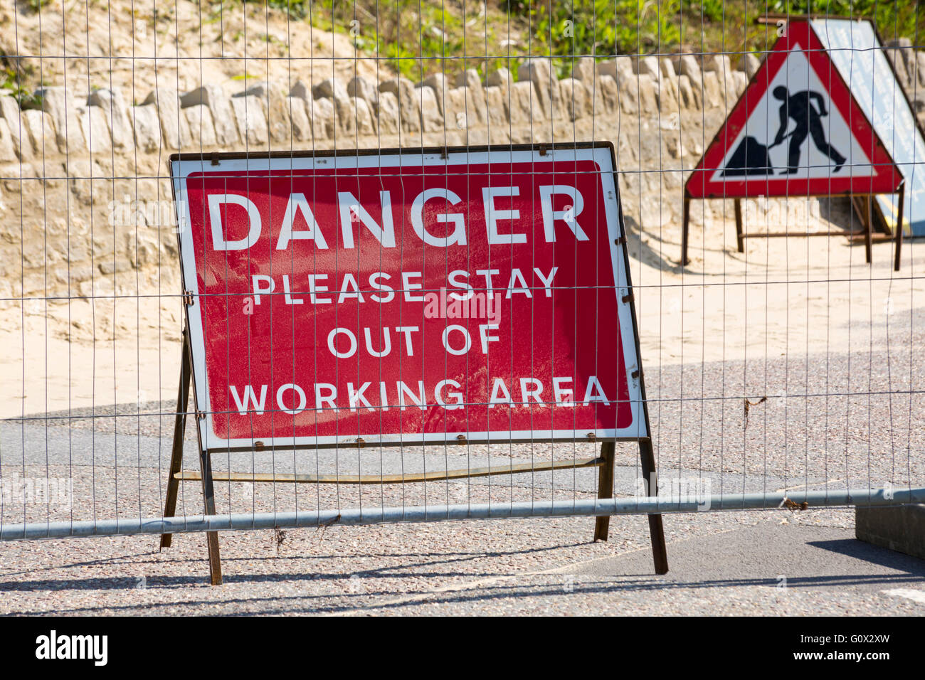Danger please stay out of working area sign following recent landslide at Eastcliff, Bournemouth in May - Stock Image