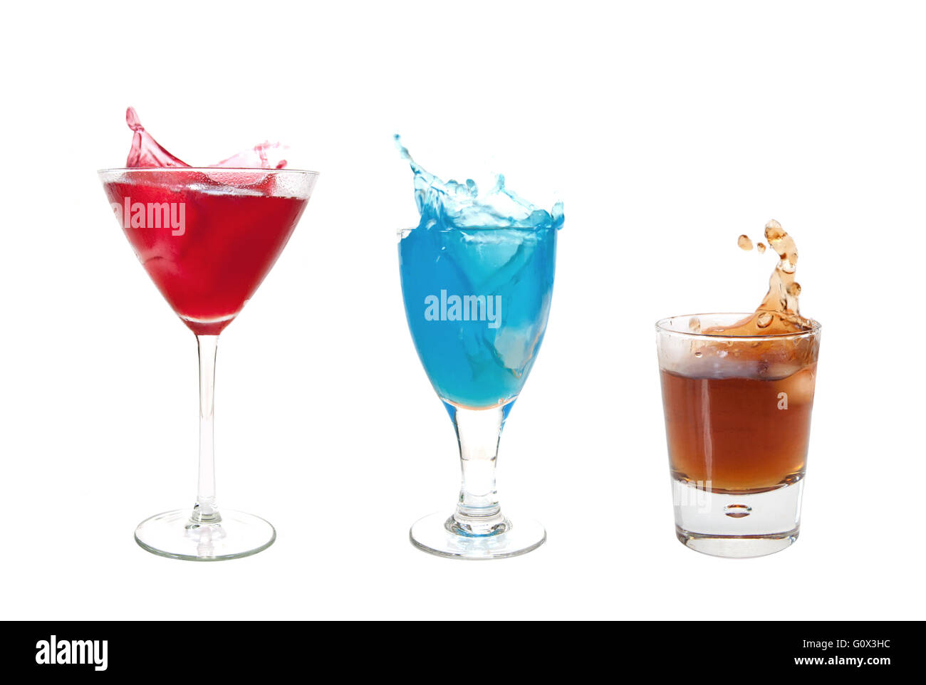 Three different cocktails with a splash over a white background - Stock Image