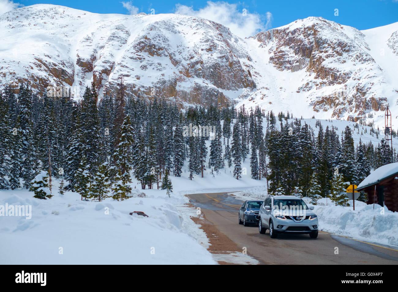 cars driving on snowy road on pike's peak, colorado springs