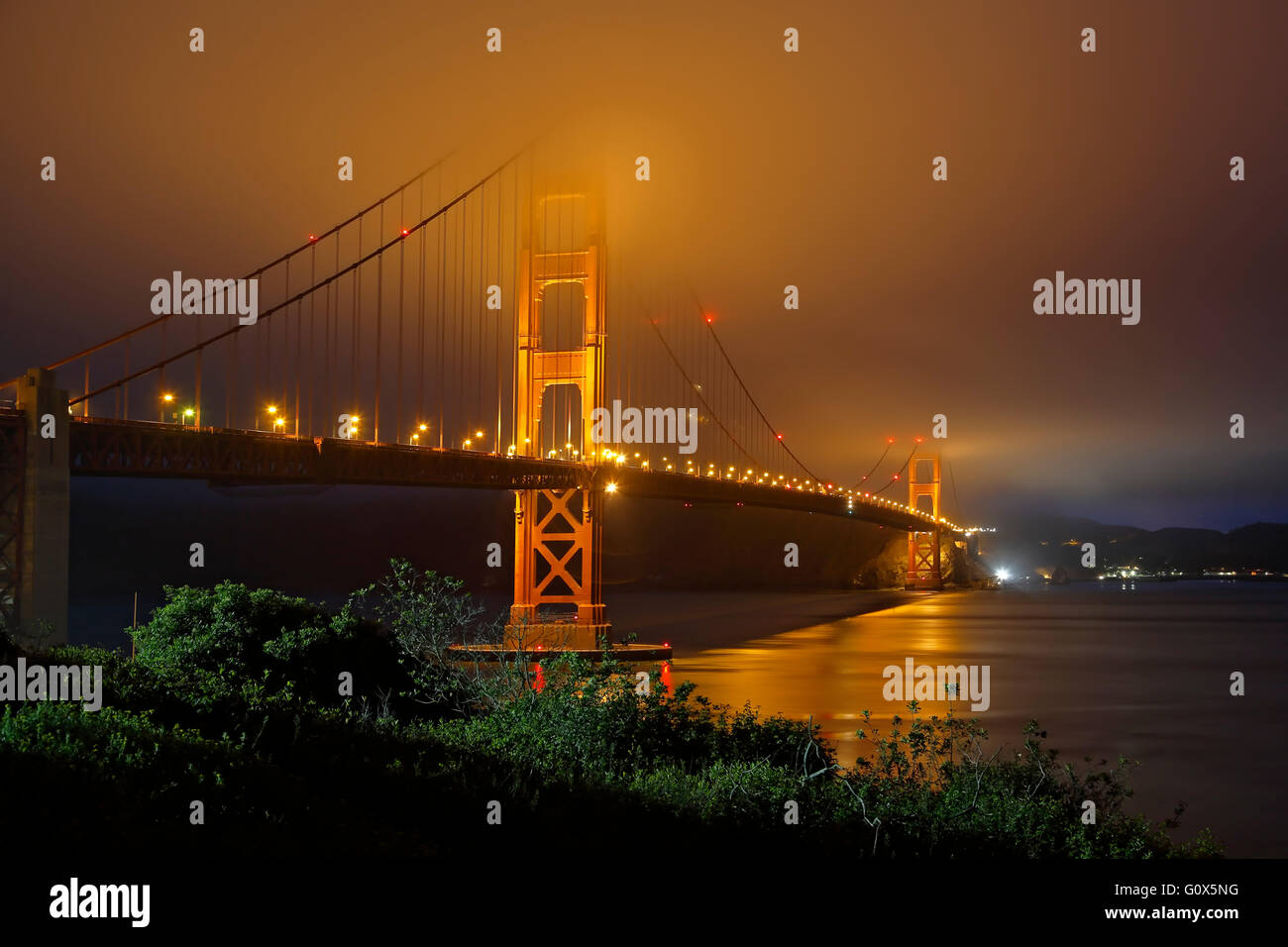 Golden Gate Bridge under fog, San Francisco, California USA - Stock Image