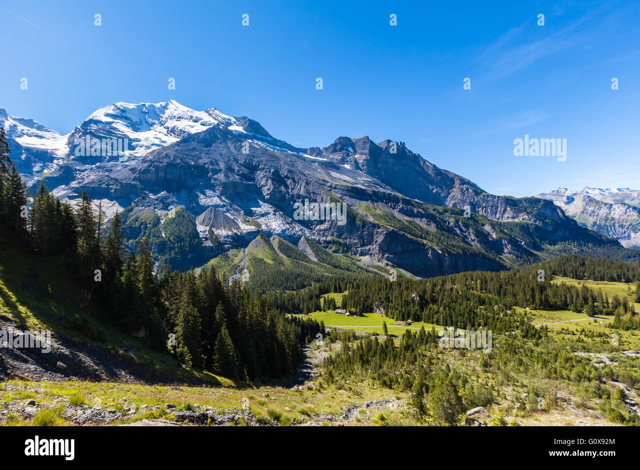 Stunning view of Bluemlisalp and Frundenhorn above Oeschinensee (Oeschinen lake), swiss alps on Bernese Oberland. - Stock Image