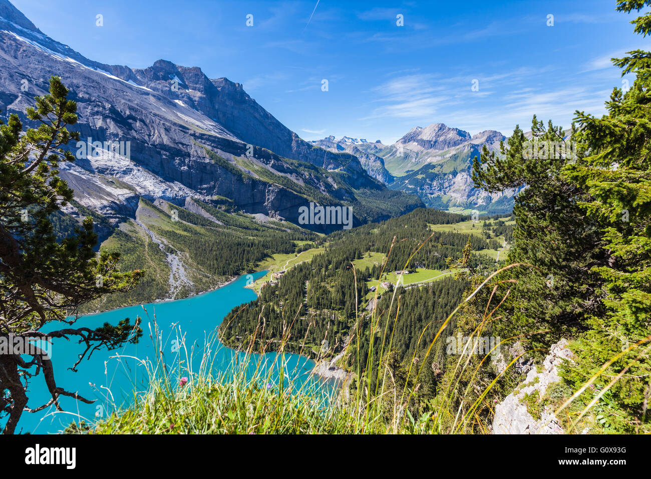 Scenic iew of Oeschinensee (Oeschinen lake) and the valley on bernese oberland, Switzerland - Stock Image