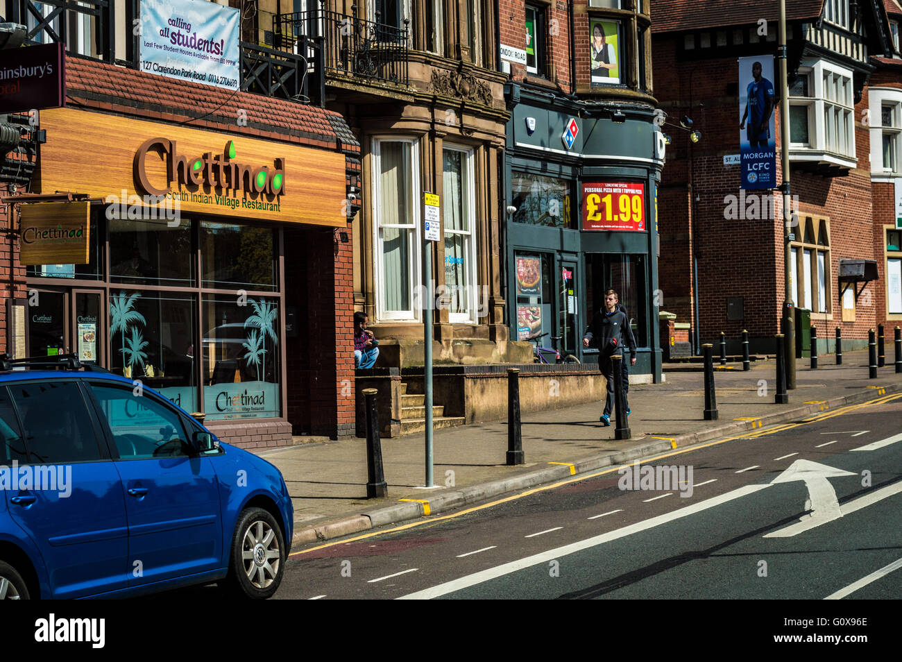 London Road, Leicester near Evington Road, Junction showing Chettinad South Indian Restaurant Domino's Pizza - Stock Image