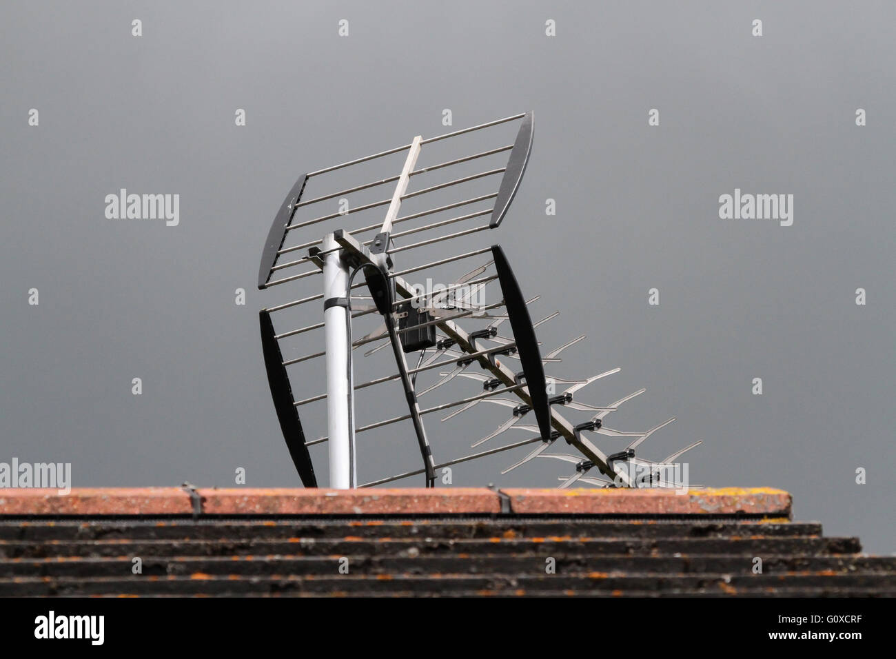 Terrestrial television aerial on UK rooftop - Stock Image