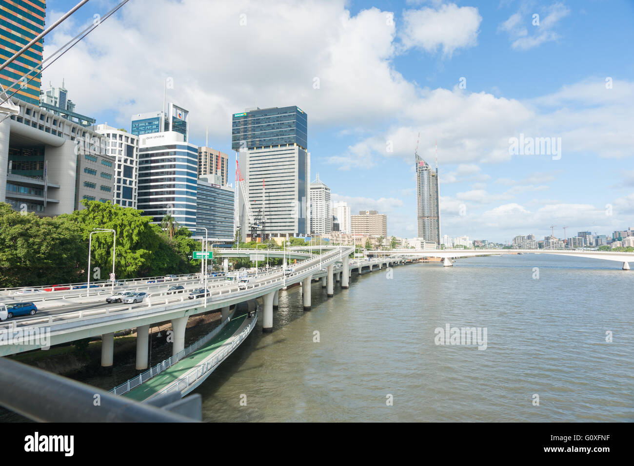 Brisbane River through city with elevated highways along the river and urban skyline in state capital, Queensland - Stock Image