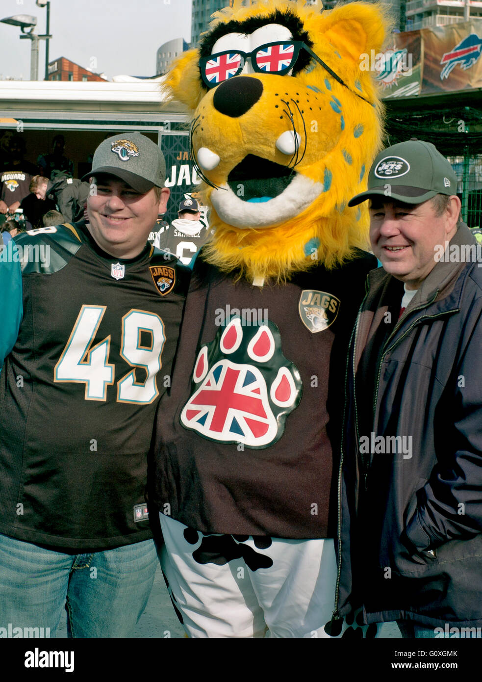 Jaxson de Ville the mascot of the Jacksonville Jaguars with two fans at Wembley stadium American football union - Stock Image