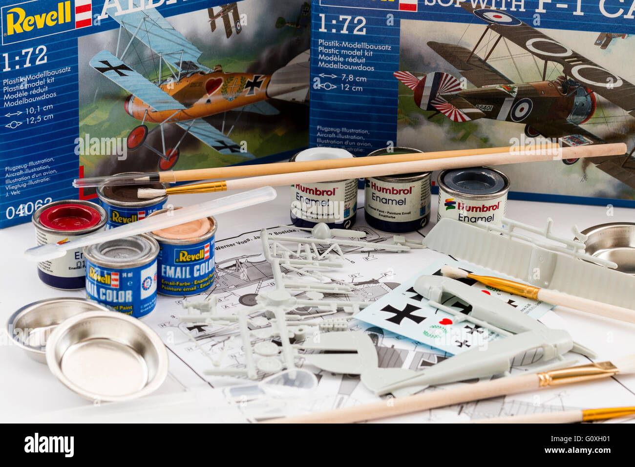 Hobby, plastic kit modelling. Background, 2 revell airplane boxes with contents of one in foreground, surrounded - Stock Image
