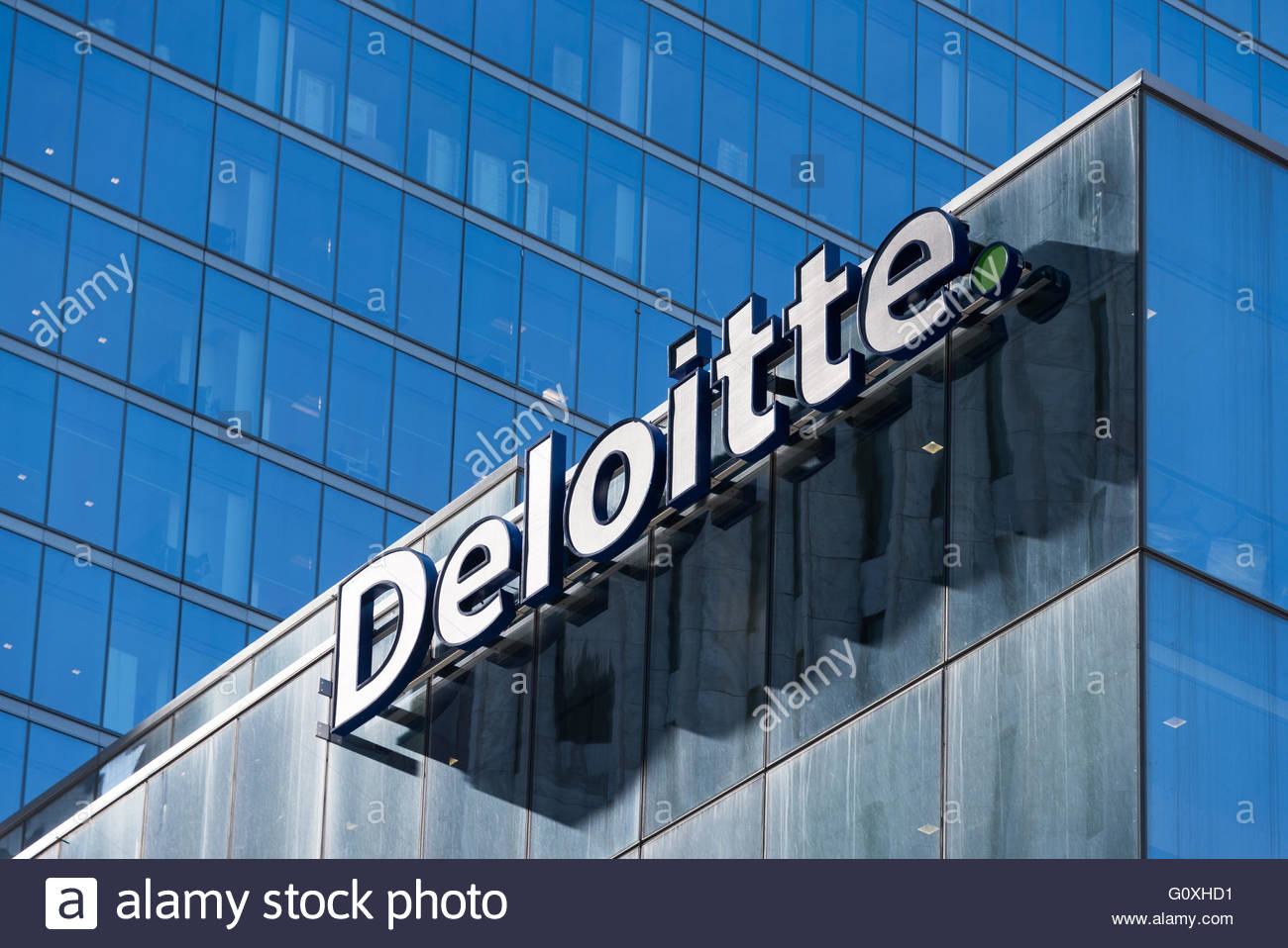 Deloitte sign on top of Toronto headquarters building. Deloitte Touche Tohmatsu Limited is a multinational professional - Stock Image