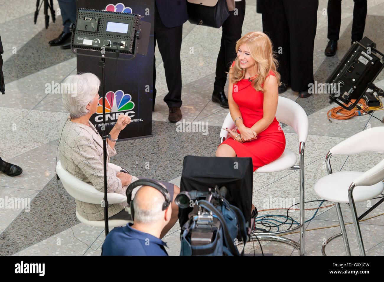 Sara Eisen of CNBC news interview set of Christine Lagarde
