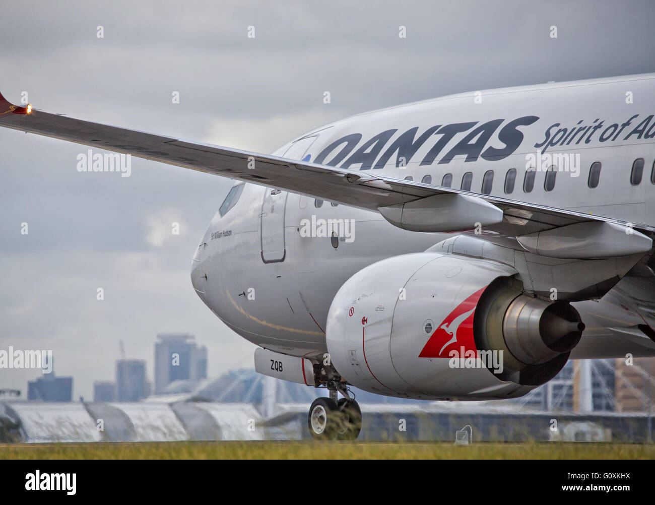 Close-up of a QANTAS Boeing 737 taxiing. Unusual angle. - Stock Image