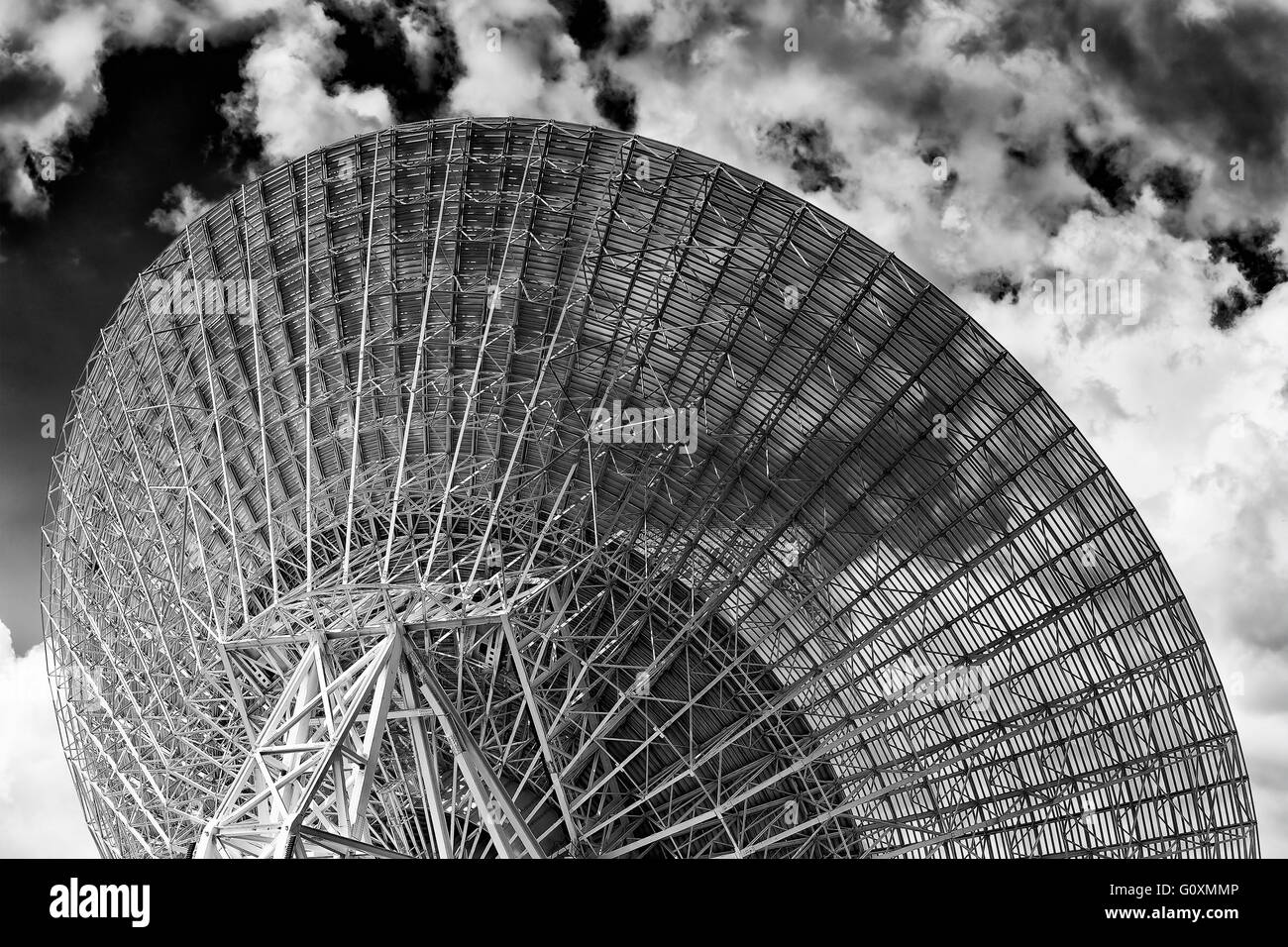 Back of huge radio antenna dish facing cloudy sky in search of space objects as part of CSIRO and NASA communication Stock Photo
