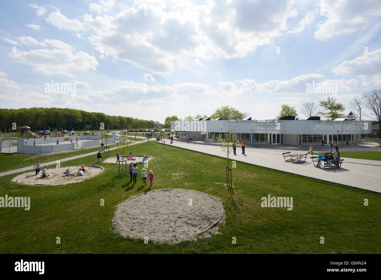 Rask Molle School. A modern single storey building, with landscaping and open spaces, benches and paths, sand pits. - Stock Image