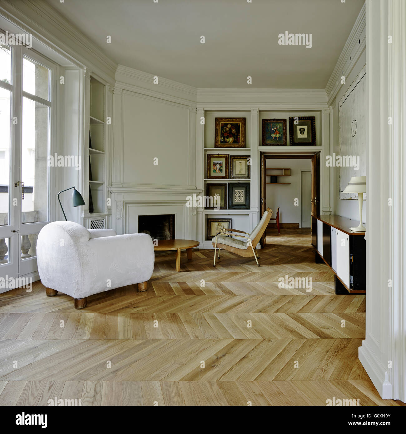 spacious open plan living room with parquet flooring and a mix of rh alamy com