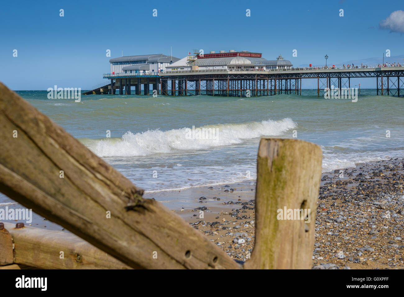 A view of Cromer Pier expands out in to the sea from the North N0rfolk coast - Stock Image