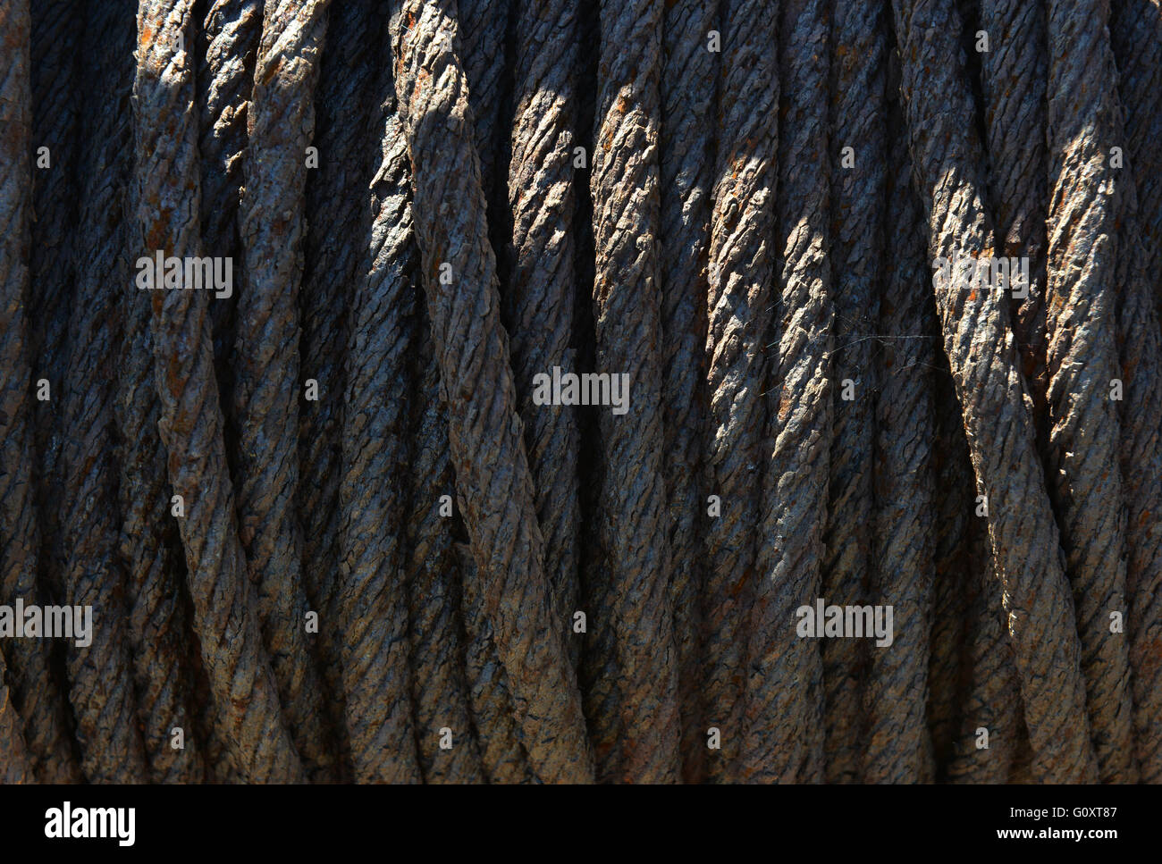 Rusty metal rope on old boat winch - Stock Image