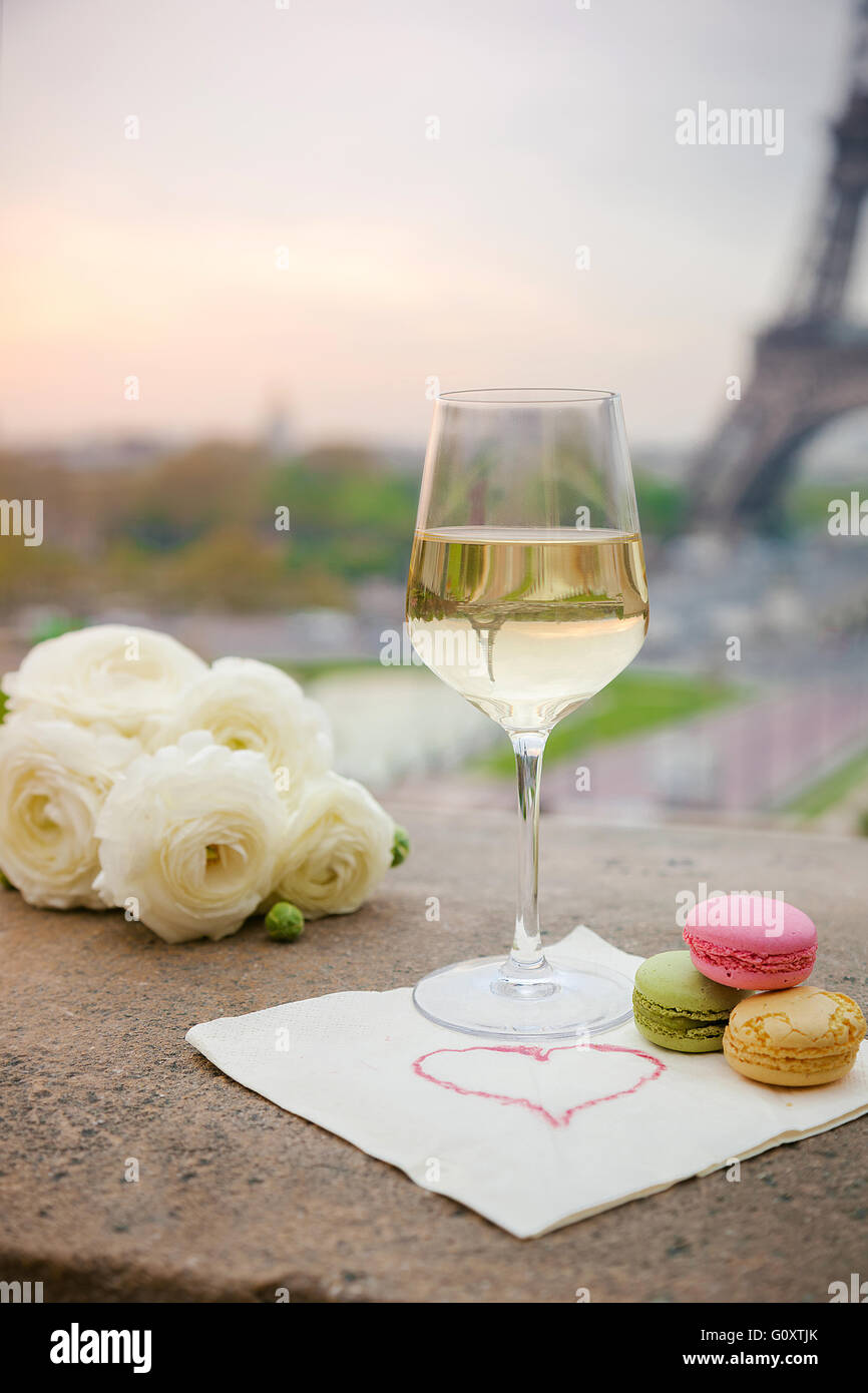 Composition of wine glasses flowers and macaroons with the view for composition of wine glasses flowers and macaroons with the view for eiffel tower in paris spring mightylinksfo