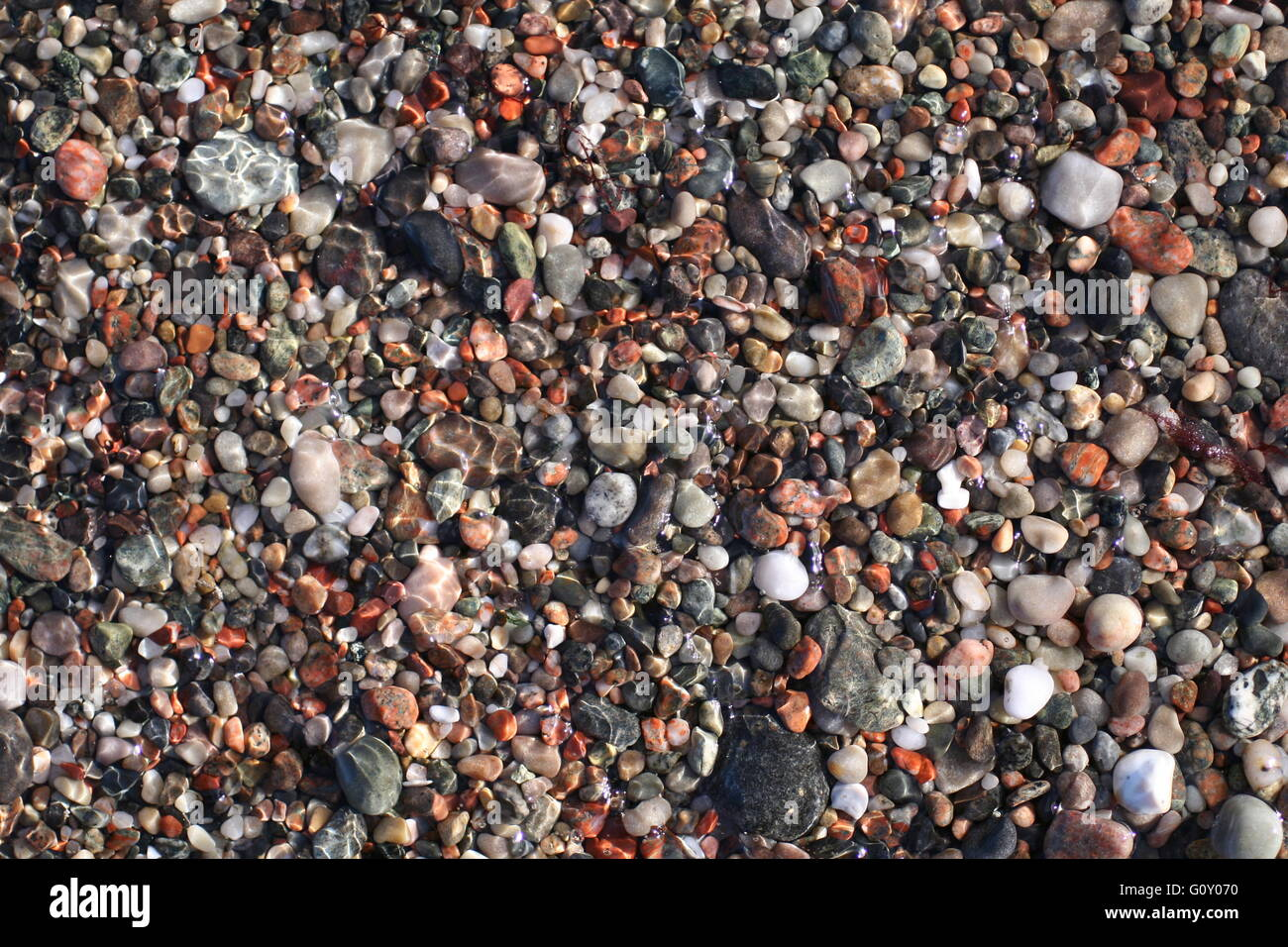 Pebble covered beach on Iona, Inner Hebrides, Scotland - Stock Image