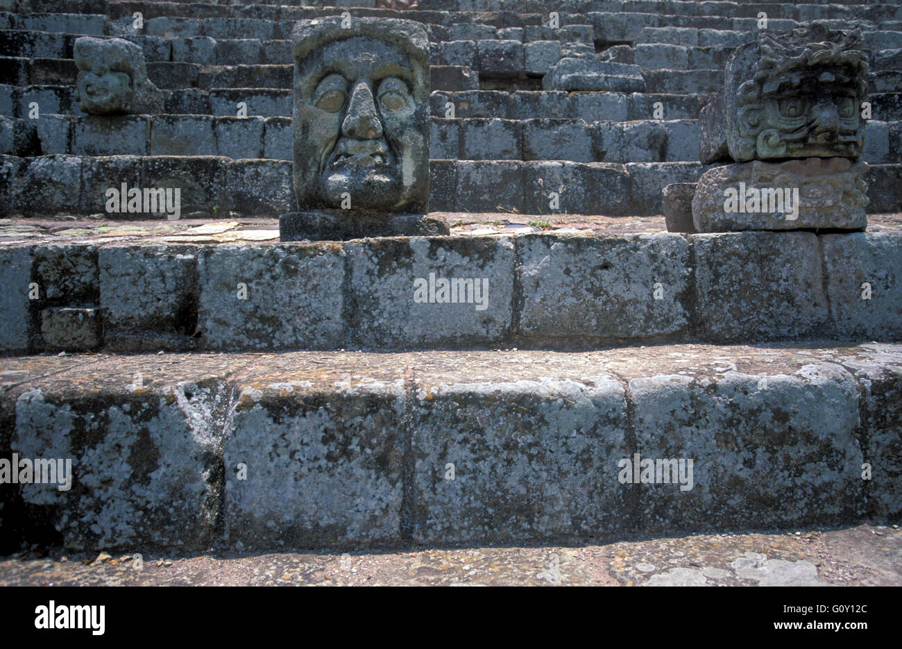 Grotesque sculptures face in Copan Ruins, an archaeological site of the Maya civilization in Copan Department, Honduras - Stock Image
