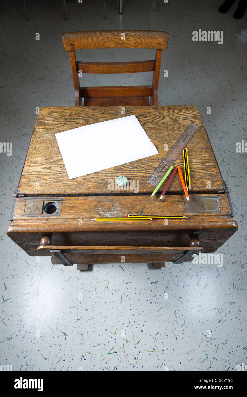 Old wooden school exam desk ready for a student to sit an ...