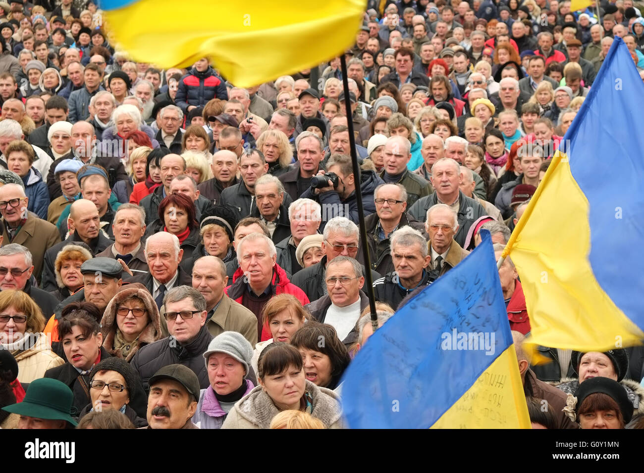 Kryvyi Rih, Ukraine - November 22, 2015: Crowd of people with Ukrainian flags at the meeting against falsification - Stock Image